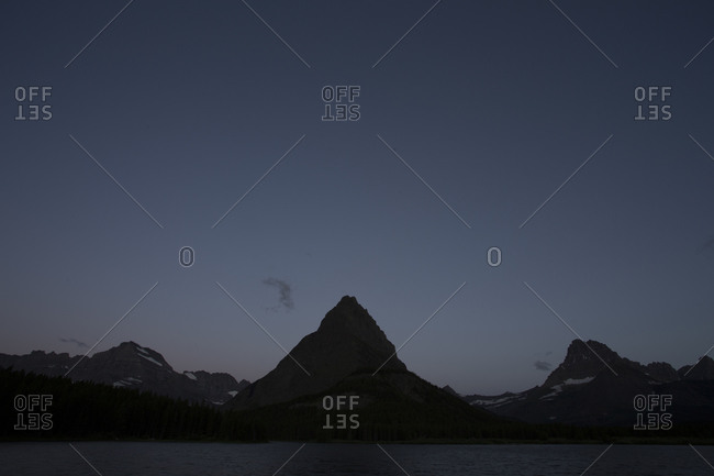 A mountain peak during twilight