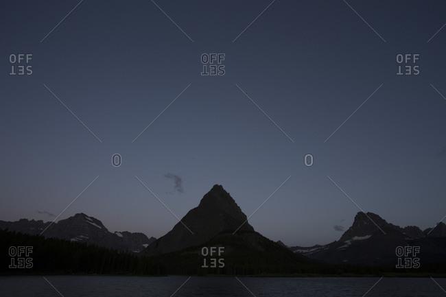 A mountain peak during twilight