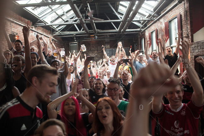 Williamsburg, Brooklyn, NY - July 13, 2013: Fans at a bar celebrate Germany's win in the soccer world cup, Williamsburg, Brooklyn