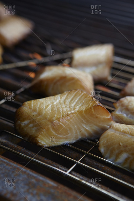 Close up of salmon fillets on grill