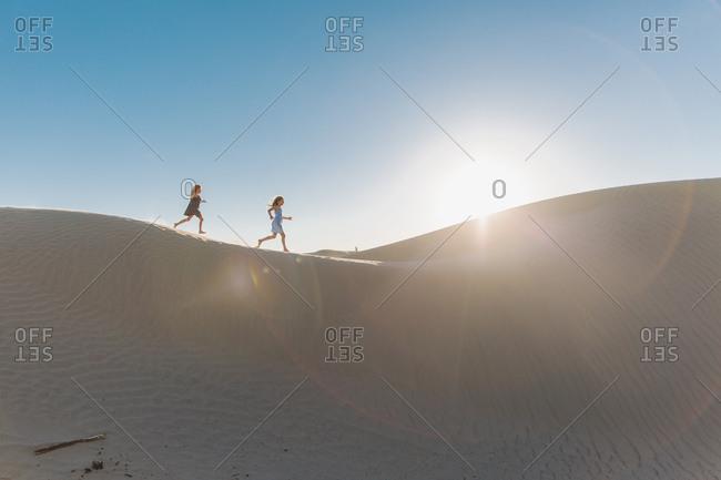 Young girls running in a desert