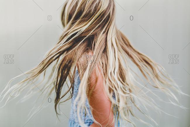 Blonde girl shaking her hair