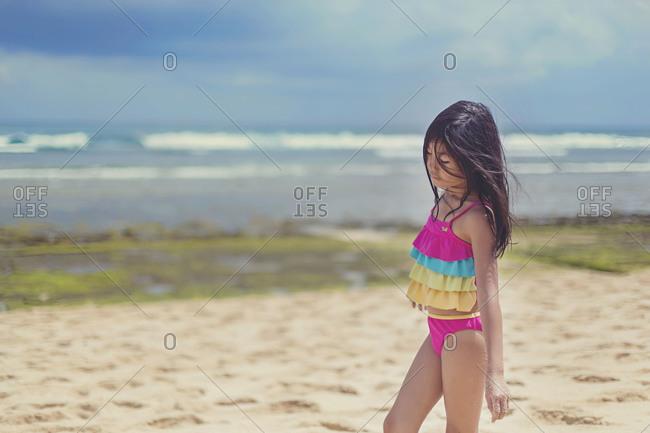 Little girl walking on the beach