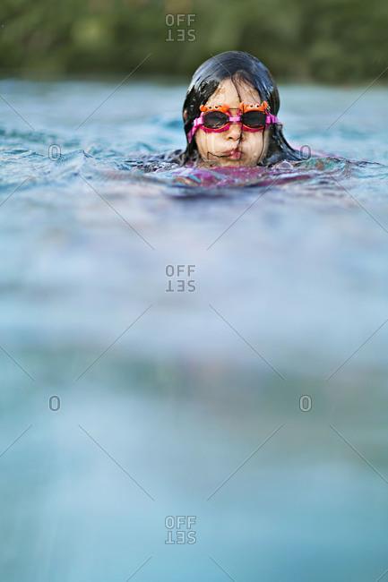 Girl wearing swim goggles in the water