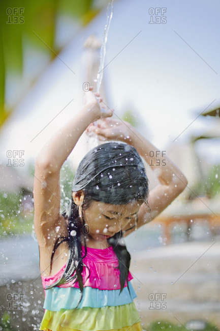 Girl playing in a stream of water