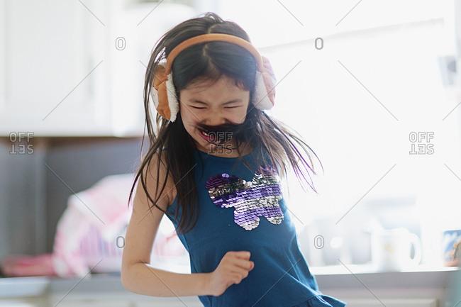 Dancing girl wearing headphones