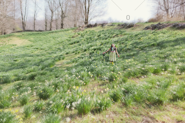 Girl standing in a meadow