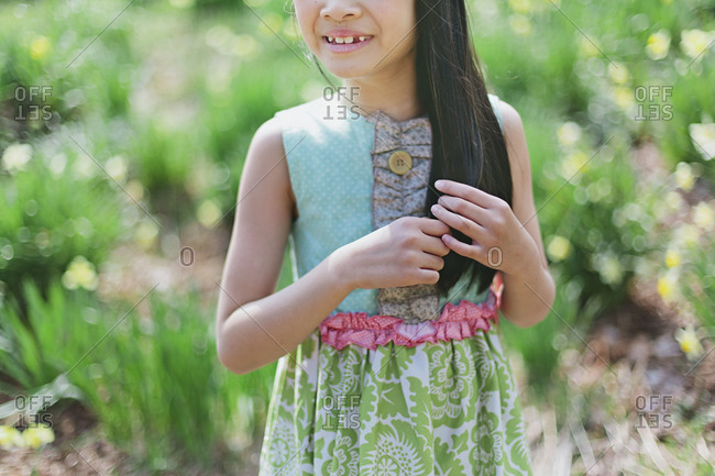 Close up of a girl standing in a meadow