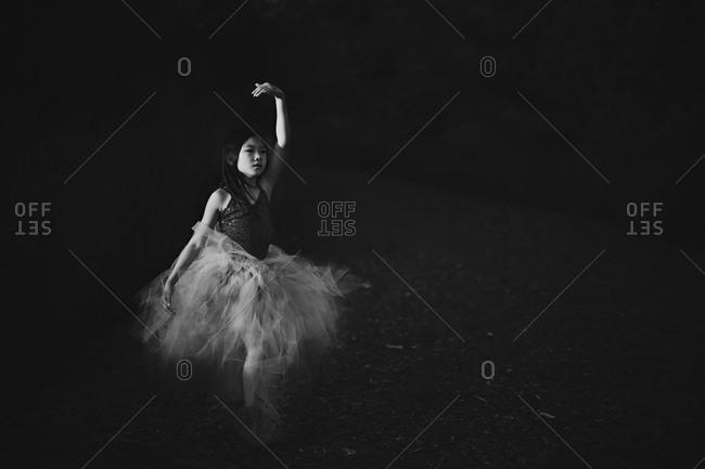 Girl dancing in a ballerina dress