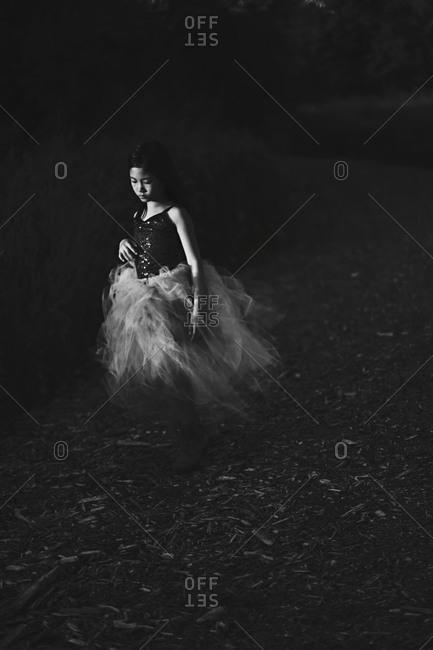 Girl wearing a ballerina costume outdoors
