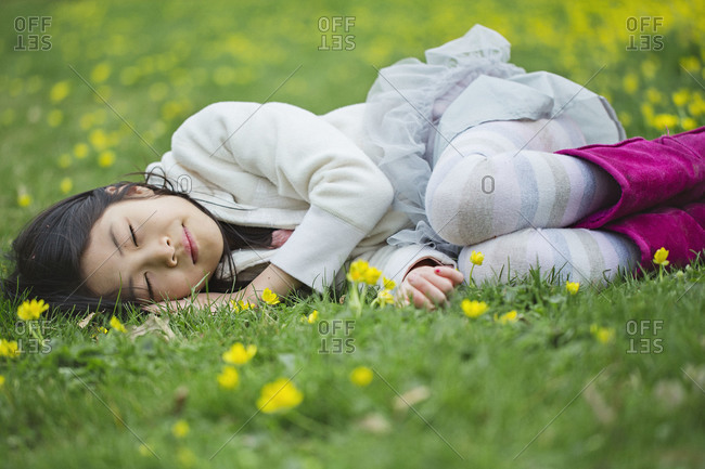 Girl lying in the grass in a meadow