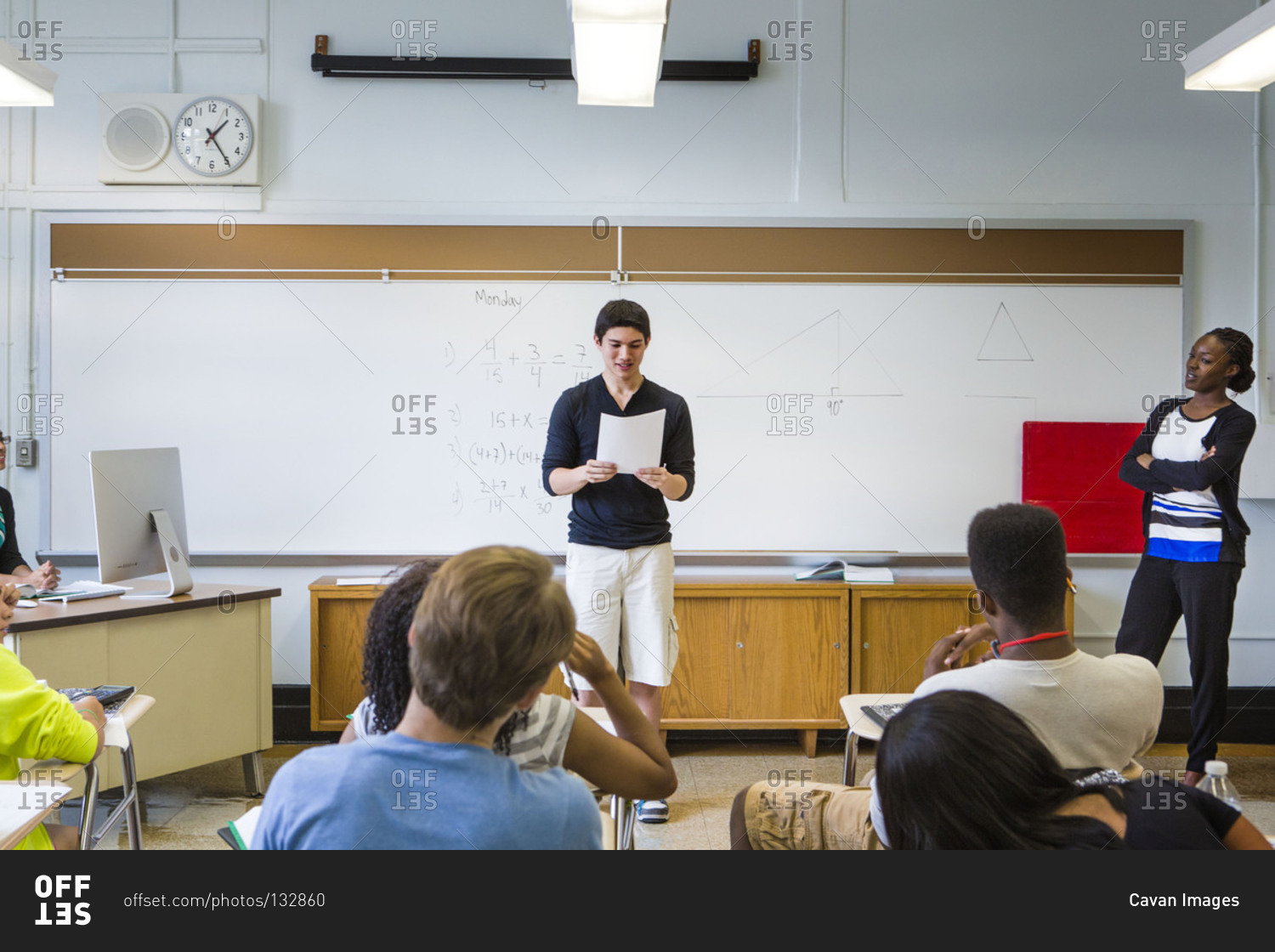 teenage boy giving a presentation in a school stock photo offset