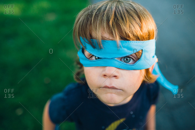 High angle view of a boy wearing super hero mask