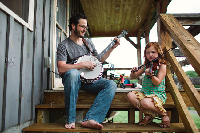 Father and his daughter playing music
