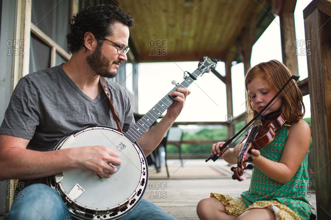 Father and daughter playing music together