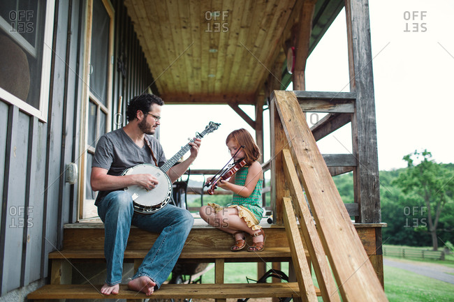 Dad and his daughter practicing on porch