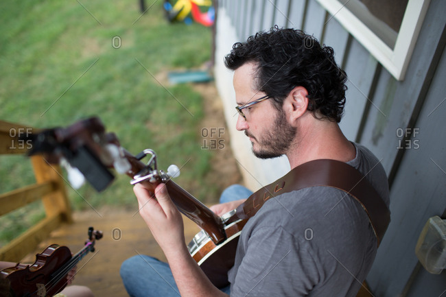 High angle view of a man playing a banjo