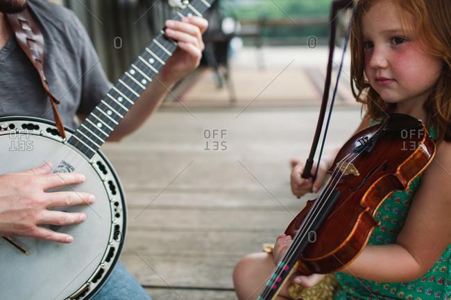 Close up of redhead girl playing a violin