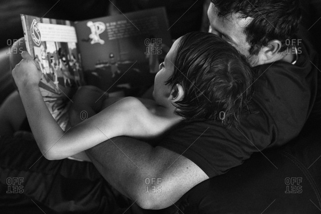 Father and son reading a story together