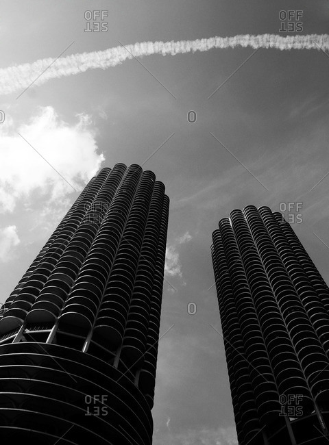 View of Marina City buildings in Chicago with contrails on the sky