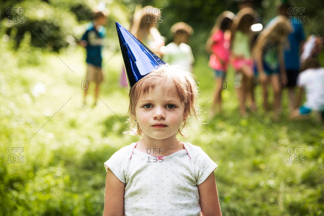 Portrait of a girl wearing birthday party hat