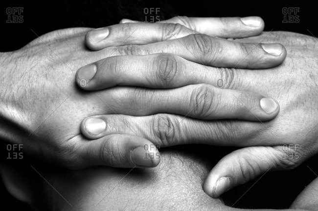 Hands clasped behind neck
