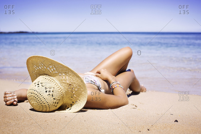 Woman sun-bathing on beach
