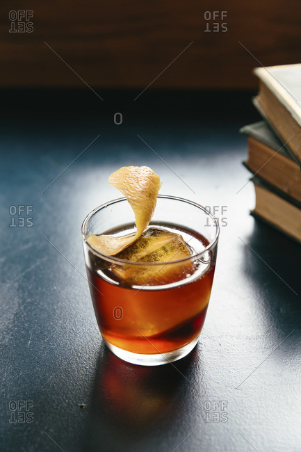Books with a cocktail on a tabletop