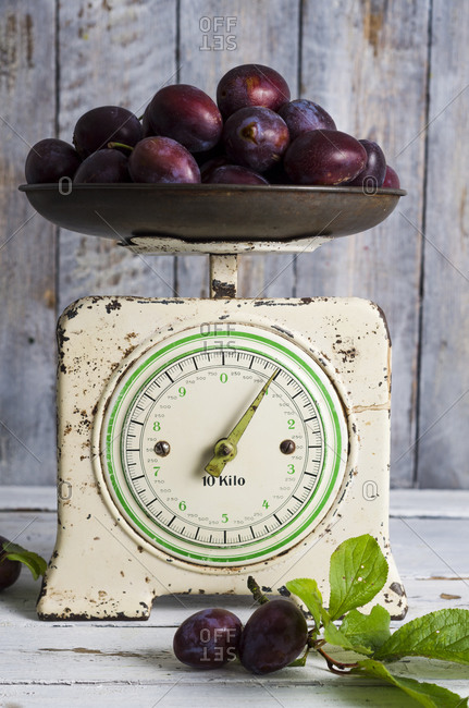 Plums on an old kitchen scale