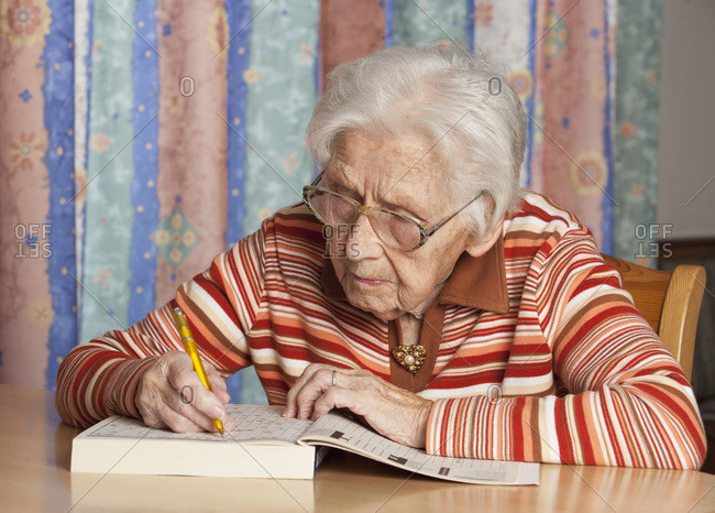 Portrait of senior woman with crossword puzzle