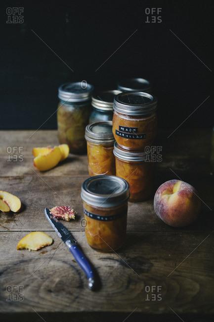Jars of peach marmalade on cupboard