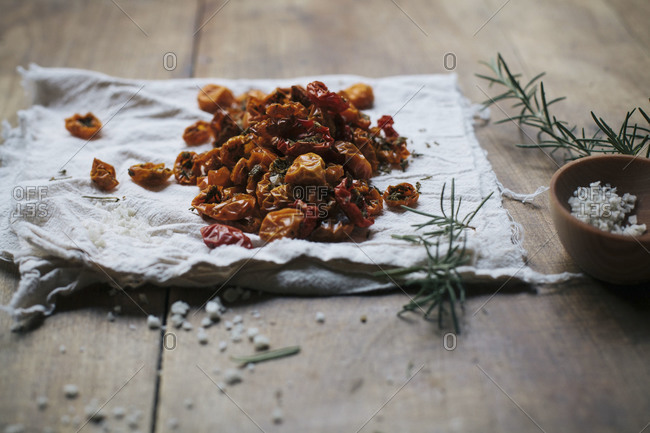 Heap of oven dried cherry tomatoes on cloth