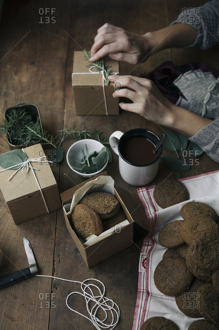 Woman gift-wrapping gingersnap cookies
