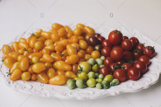 Variety of organic tomatoes on plate