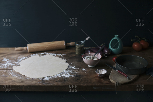 Rolled out pastry on floured wooden surface