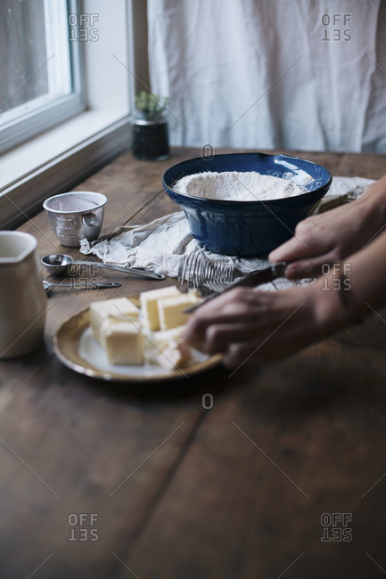 Woman cutting butter into cubes