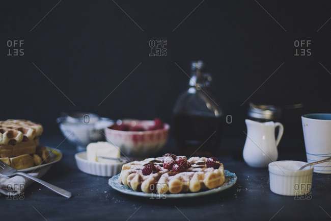 Waffles with raspberries and powdered sugar