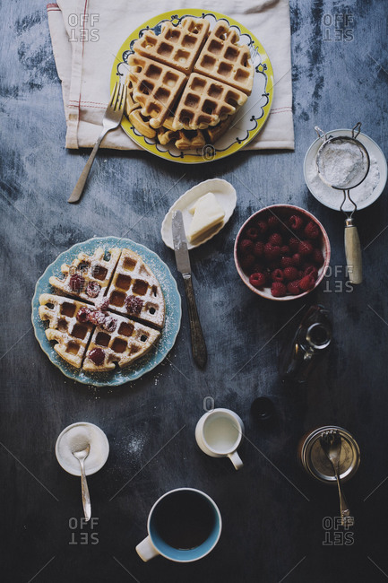 Belgian waffles with raspberries and maple syrup