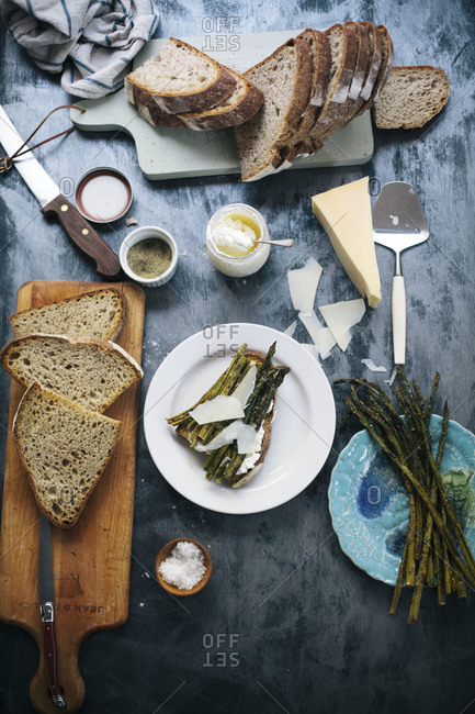 Asparagus tartine with ricotta and cheese shavings