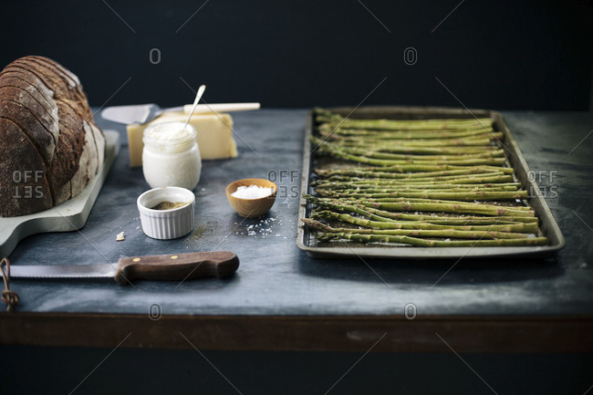 Asparagus prepared for baking in a pan