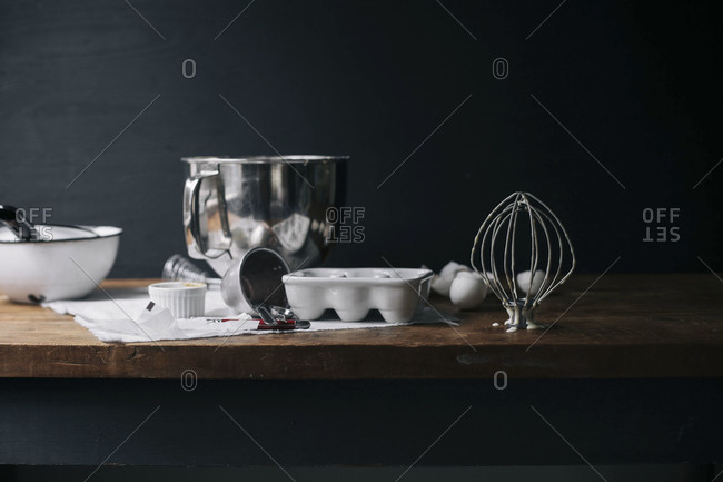 Messy table with cooking utensils