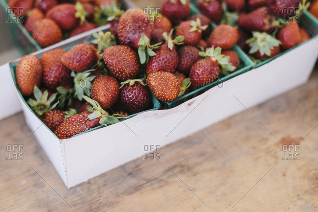 Fresh strawberries in boxes at a market