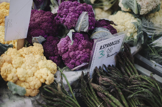Yellow, purple and white cauliflowers at a farmer's market