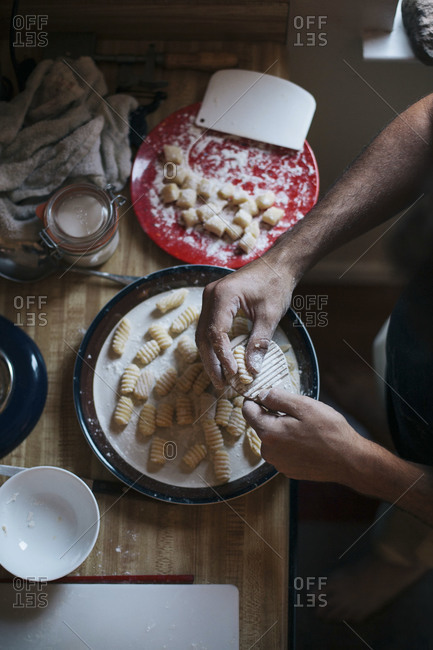 Man preparing potato gnocchi at home