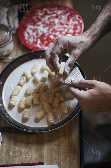 Man preparing handmade gnocchi