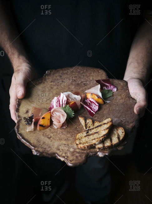 Man holding a charcuterie board