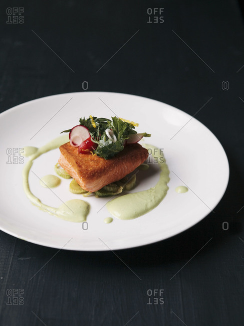 Salmon fillet with celery and radish salad