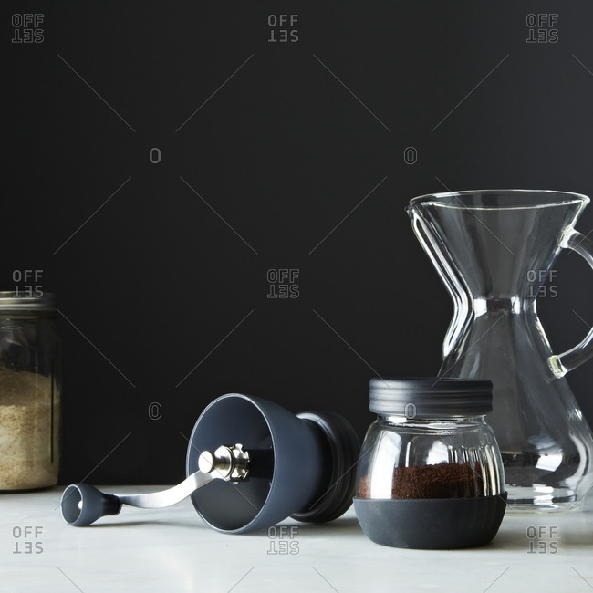 Coffee grinder with a jug on a table