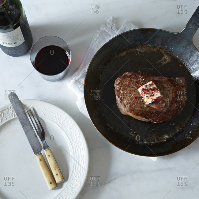 Pan fried steak with a blot of butter and red wine