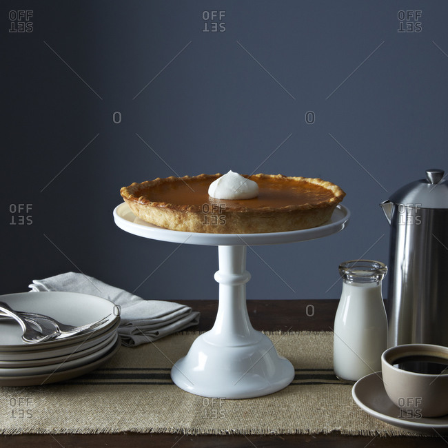 Pumpkin pie on a cake stand